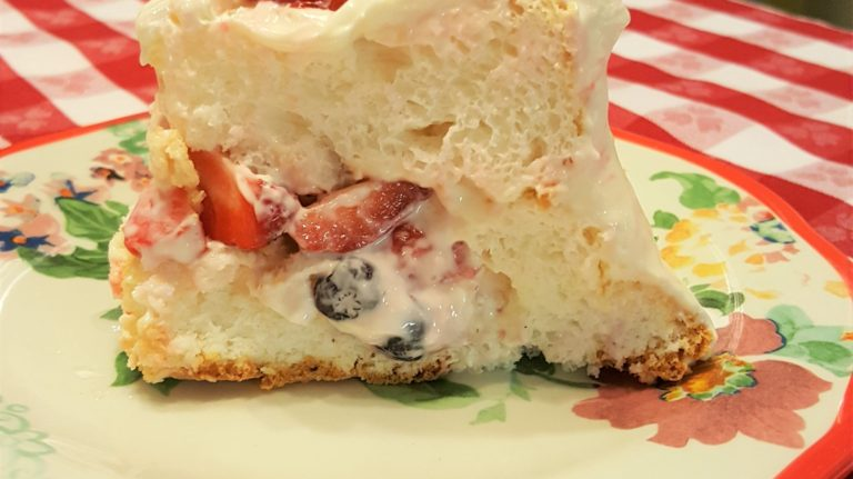Berry filled angel food cake with cream cheese frosting rosalie most everyone loves angel food cake and to be filled with fresh berries is even more wonderful the cream cheese frosting only adds to all forumfinder Gallery